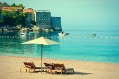 Beautiful beach with sunshades in Montenegro, Balkans, Adriatic Sea royalty free stock photos