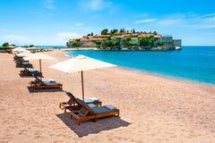 Beautiful beach and Sveti Stefan island near Budva, Montenegro. Luxury resort at Adriatic sea. Famous travel destination stock image