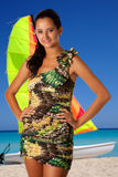 Beautiful beach swim suit model with retro style swim suit near catamaran boat. Royalty Free Stock Photos