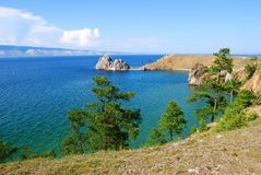Beautiful beach with trees and rock. The shore of Lake Baikal.