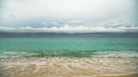 Beautiful beach on tropical island in stormy weather. Boracay island Philippines. Beautiful tropical island with white sand beach and tourists in stormy weather stock video footage