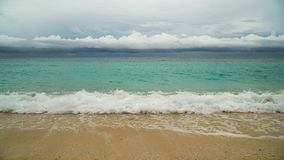 Beautiful beach on tropical island in stormy weather. Boracay island Philippines. Beautiful tropical island with white sand beach and tourists in stormy weather stock video