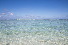 Beautiful beach and tropical sea on clear day Stock Image