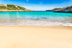 Beautiful beach with turquoise blue ocean water and view of idyllic bay. Beautiful beach with turquoise ocean water at Cala Marcal, idyllic seaside on Majorca Royalty Free Stock Image