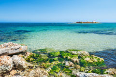 Beautiful beach with turquoise water and stones Royalty Free Stock Photos