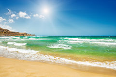 Beautiful beach with turquoise water and white sand Stock Photos
