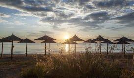 Beautiful Beach with umbrellas. Before sunset Stock Photo