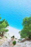 Beautiful beach under a high cliff Royalty Free Stock Images