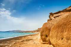 Beautiful beach with unusual volcanic mountains and turquoise wa Stock Photo