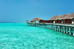 Beautiful beach with water bungalows Stock Photo
