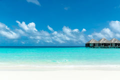 Beautiful beach with water bungalows Royalty Free Stock Images