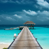 Beautiful beach with water bungalows Royalty Free Stock Photos