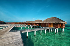 Beautiful beach with water bungalows Royalty Free Stock Image