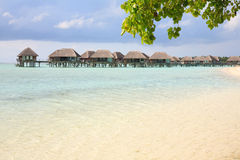 Beautiful beach. With water bungalows at Maldives Stock Photos