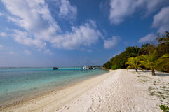 Beautiful beach with water bungalows at Maldives. Royalty Free Stock Photography