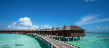 Beautiful beach with water bungalows at Maldives, panorama forma Royalty Free Stock Images