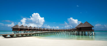 Beautiful beach with water bungalows at Maldives, panorama format.  royalty free stock images