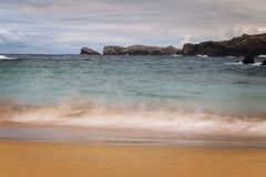 Beach with waves and without people. Beautiful beach with waves breaking on the shore and without people Stock Image
