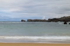 Beach with waves and without people. Beautiful beach with waves breaking on the shore and without people Stock Photos
