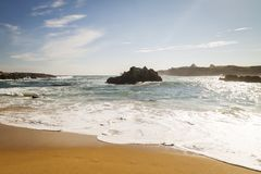 Beach with waves and without people. Beautiful beach with waves breaking on the shore and without people Royalty Free Stock Images