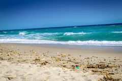 Beautiful beach with waves crashing royalty free stock images
