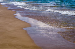 Beautiful beach waves. Mediterranean sea, smooth sand and waves Stock Photo