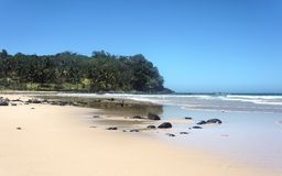 The beautiful beach of white sand , the sea and trees . Royalty Free Stock Image