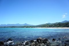 The beautiful beach of white sand , the sea and trees . Royalty Free Stock Photography
