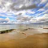 Beautiful  beach with a wooden breakwater Stock Photo