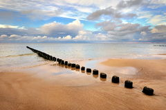 Beautiful  beach with a wooden breakwater Royalty Free Stock Image
