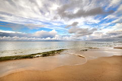 Beautiful  beach with a wooden breakwater Royalty Free Stock Photos