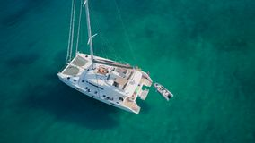 Beautiful beach with yacht top aerial view drone shot stock video footage