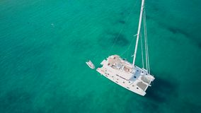 Beautiful beach with yacht top aerial view drone shot stock video