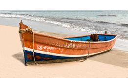 Beautiful beached Canoe, painted colorful in traditional Asian colors, this is powered by generator and used by local fishermen. Beautiful beached Canoe, painted royalty free stock images