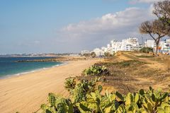 Beautiful beaches and cliffs in Quarteira, Algarve, Portugal Royalty Free Stock Photography