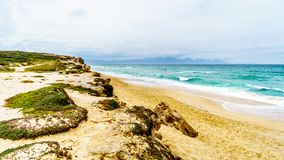 The beautiful beaches on False Bay along Baden Powell Drive between Macassar and Muizenberg near Cape Town. South Africa Royalty Free Stock Photos