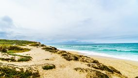 The beautiful beaches on False Bay along Baden Powell Drive between Macassar and Muizenberg near Cape Town. South Africa Royalty Free Stock Image