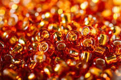 Beautiful beads with bokeh. Beautiful red beads in depth of field Royalty Free Stock Image