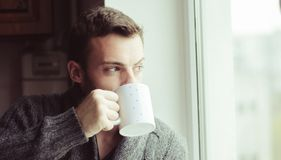 Beautiful bearded man drinking coffee stock images
