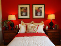 Beautiful Bed Room. Beautiful luxury  bed room with red walls and black lamps Royalty Free Stock Photos