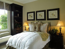 Beautiful Bed Room. With a window seat warm colors Royalty Free Stock Photos