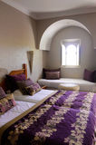 Beautiful Bedroom with Arabic Window, Home Architecture. Bedroom with white, purple and pink tones. Arabic window architecture Royalty Free Stock Image