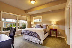 Beautiful bedroom with carpet and windows. Stock Photography