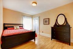 Beautiful bedroom with dark brown furniture Stock Image