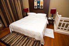 Beautiful bedroom with an en suite bathroom. Royalty Free Stock Photos