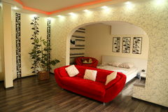 Beautiful bedroom interior. With red sofa. General appearance Stock Image