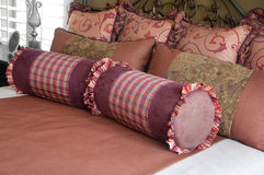 Beautiful bedroom textiles and bedding. Photo of beautiful bedroom textiles and bedding Stock Images