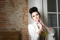 Beautiful beguiling serious young woman Stock Photography