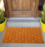 Beautiful Beige color zig-zag patterned Welcome zute doormat with border outside home with yellow flowers and leaves. Beautiful Beige color zig-zag patterned royalty free stock image