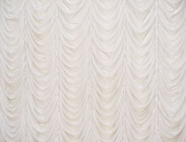 Beautiful beige curtain. With the waves Royalty Free Stock Photos